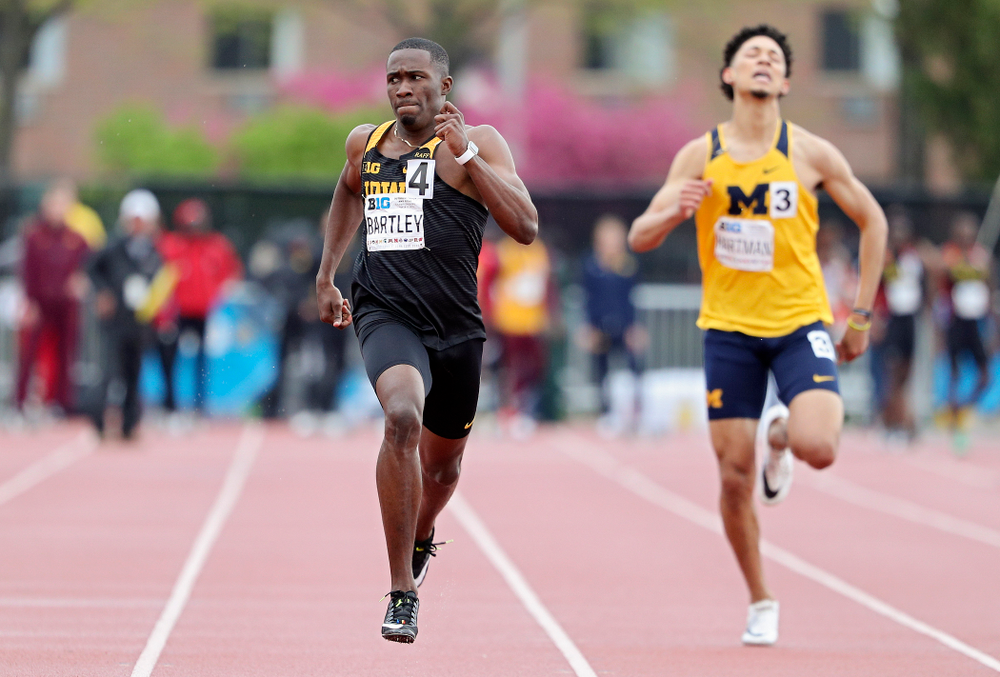 Iowa's Karayme Bartley glances over as he runs the men's 400 meter dash event on the second day of the Big Ten Outdoor Track and Field Championships at Francis X. Cretzmeyer Track in Iowa City on Saturday, May. 11, 2019. (Stephen Mally/hawkeyesports.com)