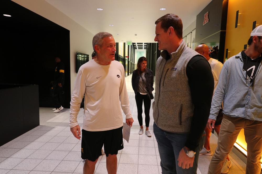 Iowa Hawkeyes head coach Kirk Ferentz talks with  AJ Edds Friday, October 11, 2019 at the Hansen Football Performance Center. (Brian Ray/hawkeyesports.com)