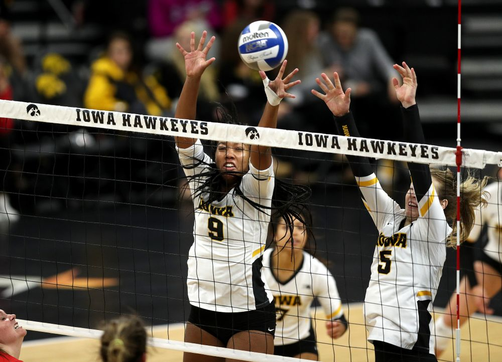 Iowa Hawkeyes middle blocker Amiya Jones (9) and outside hitter Meghan Buzzerio (5) against the Ohio State Buckeyes Saturday, November 24, 2018 at Carver-Hawkeye Arena. (Brian Ray/hawkeyesports.com)