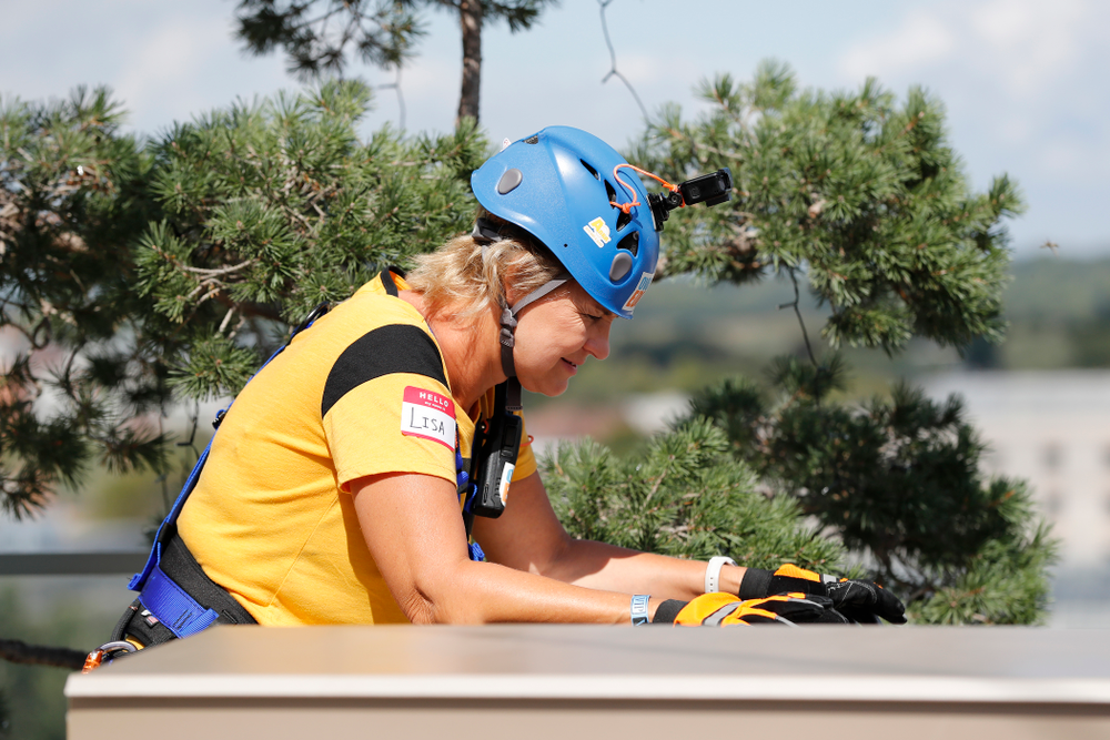 Iowa Women's Basketball head coach Lisa Bluder goes Over The Edge to benefit Ronald McDonald House Charities of Eastern Iowa and Western Illinois Friday, September 14, 2018 in downtown Iowa City.(Brian Ray/hawkeyesports.com)