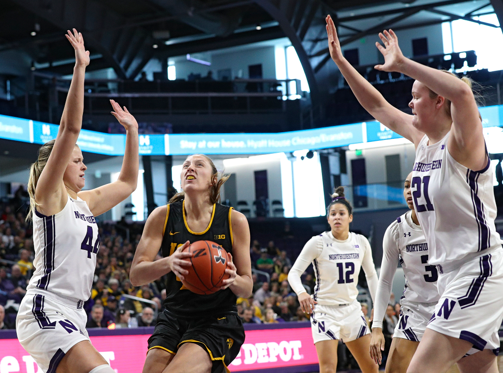 Iowa Hawkeyes forward Amanda Ollinger (43) drives to the basket for a score during the first quarter of their game at Welsh-Ryan Arena in Evanston, Ill. on Sunday, January 5, 2020. (Stephen Mally/hawkeyesports.com)
