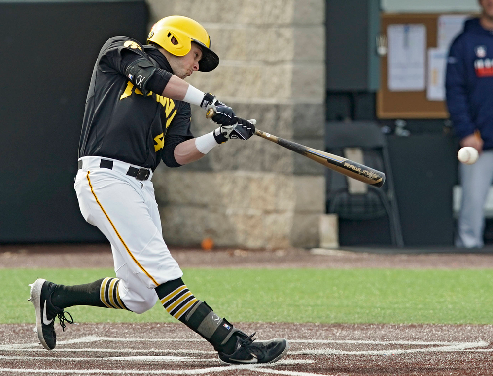 Iowa Hawkeyes second baseman Mitchell Boe (4) drives a pitch for a single during the fourth inning of their game against Illinois at Duane Banks Field in Iowa City on Saturday, Mar. 30, 2019. (Stephen Mally/hawkeyesports.com)