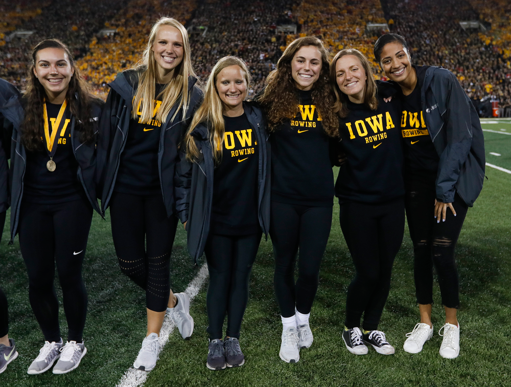 Members of the Iowa rowing team are recognized by the Presidential Committee on Athletics at halftime during a game against Wisconsin on September 22, 2018. (Tork Mason/hawkeyesports.com)