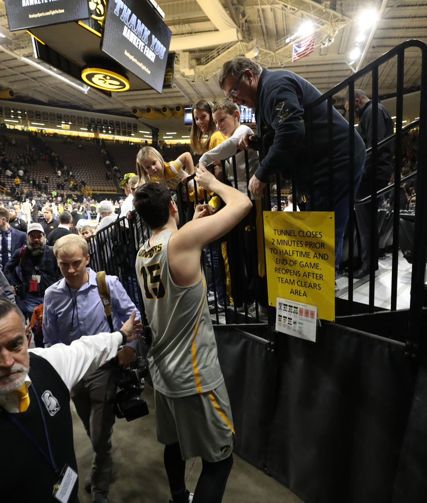 Iowa Hawkeyes forward Ryan Kriener (15) talks with Mike Street and family following their game against the Nebraska Cornhuskers Sunday, January 6, 2019 at Carver-Hawkeye Arena. (Brian Ray/hawkeyesports.com)