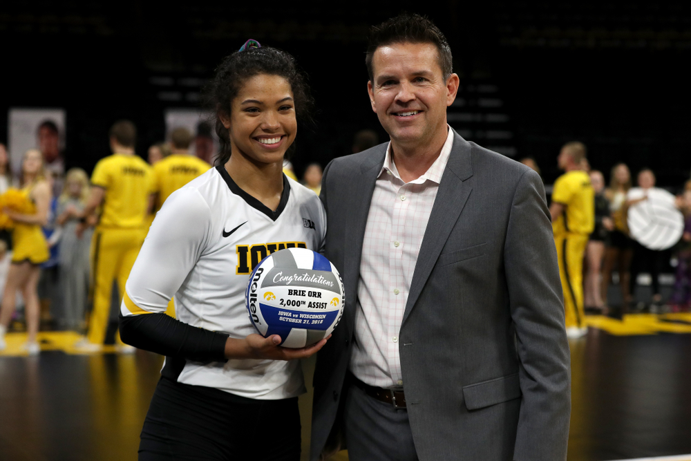 Iowa Hawkeyes setter Gabrielle Orr (7) receives a ball commemorating her 2,000th assist from head coach Bond Shymansky before their game against the Northwestern Wildcats Wednesday, October 24, 2018 at Carver-Hawkeye Arena. (Brian Ray/hawkeyesports.com)