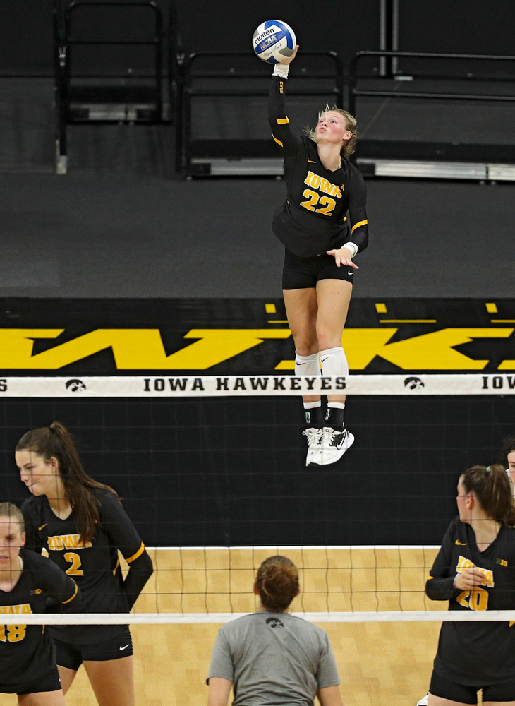 Iowa's Jaedynn Evans (22) serves during the third set of the Black and Gold scrimmage at Carver-Hawkeye Arena in Iowa City on Saturday, Aug 24, 2019. (Stephen Mally/hawkeyesports.com)