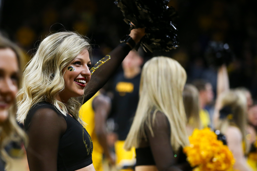 An Iowa Spirit Squad member smiles to the crowd during the Iowa men's basketball game vs Rutgers on Wednesday, January 22, 2020 at Carver-Hawkeye Arena. (Lily Smith/hawkeyesports.com)