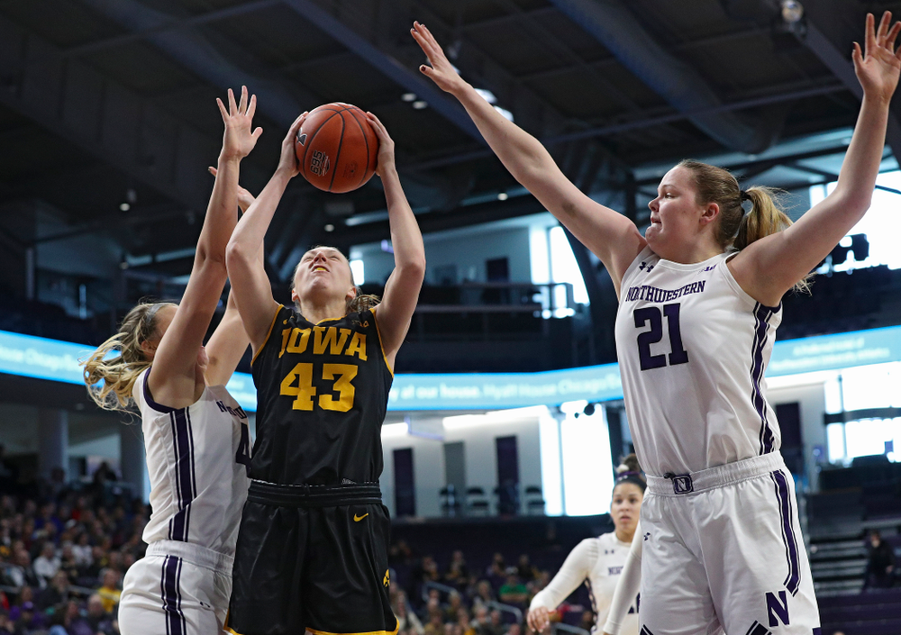 Iowa Hawkeyes forward Amanda Ollinger (43) makes a basket during the first quarter of their game at Welsh-Ryan Arena in Evanston, Ill. on Sunday, January 5, 2020. (Stephen Mally/hawkeyesports.com)