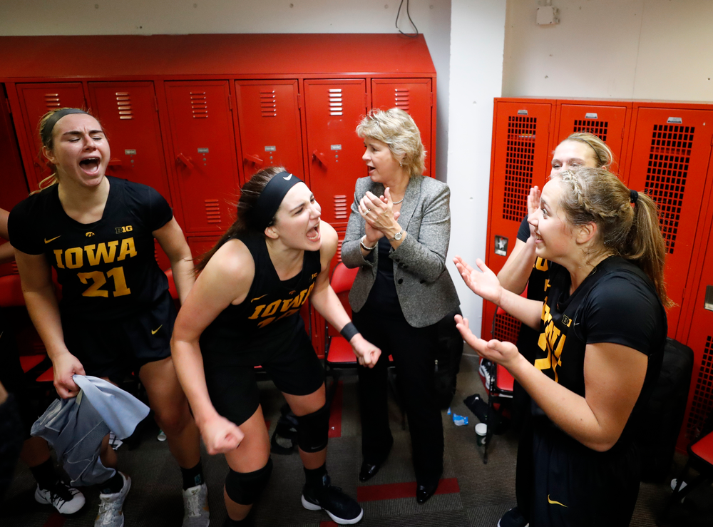 Iowa Hawkeyes forward Megan Gustafson (10) and guard Kathleen Doyle (22)