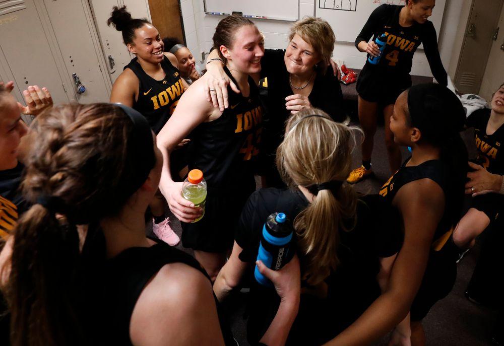Iowa Hawkeyes head coach Lisa Bluder  and Iowa Hawkeyes forward Amanda Ollinger (43)