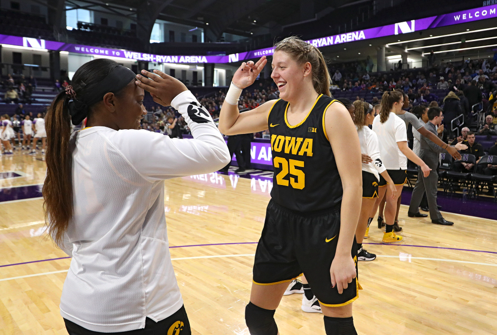 Iowa Hawkeyes forward Monika Czinano (25) is introduced before their game at Welsh-Ryan Arena in Evanston, Ill. on Sunday, January 5, 2020. (Stephen Mally/hawkeyesports.com)