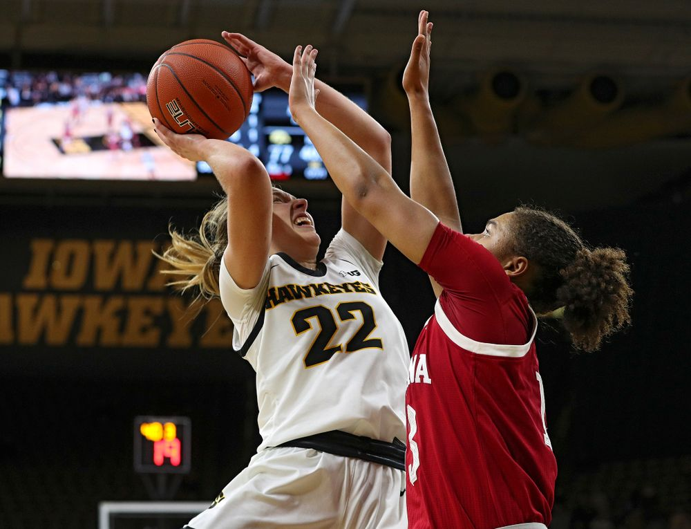 Iowa Hawkeyes guard Kathleen Doyle (22) shoots during the first overtime period of their game at Carver-Hawkeye Arena in Iowa City on Sunday, January 12, 2020. (Stephen Mally/hawkeyesports.com)