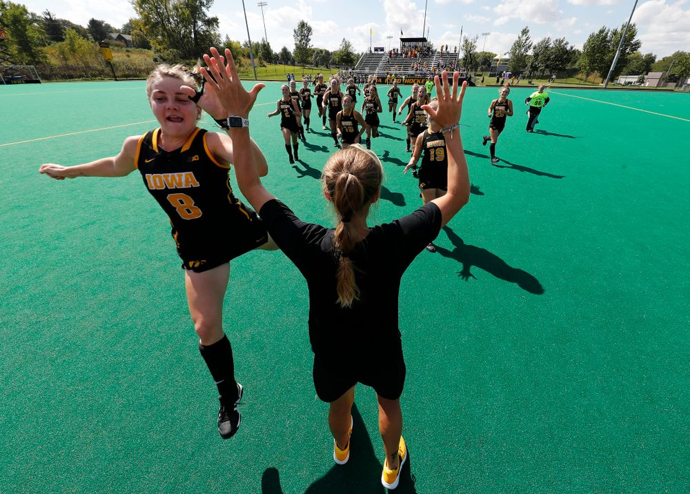 Iowa Hawkeyes Nikki Freeman (8) high fives assistant coach Roz Ellis before their game against the Penn Quakers Friday, September 14, 2018 at Grant Field. (Brian Ray/hawkeyesports.com)