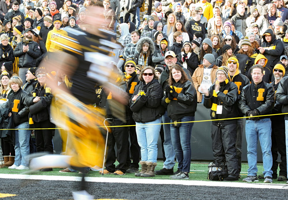 University of Iowa letterwinners form a tunnel as punter Colten Rastetter (7) is acknowledged on senior day before their game at Kinnick Stadium in Iowa City on Saturday, Nov 23, 2019. (Stephen Mally/hawkeyesports.com)