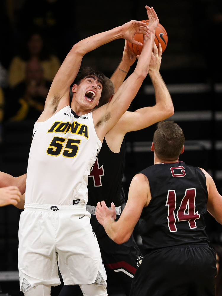 Iowa Hawkeyes forward Luka Garza (55) goes up for a rebound during a game against Guilford College at Carver-Hawkeye Arena on November 4, 2018. (Tork Mason/hawkeyesports.com)