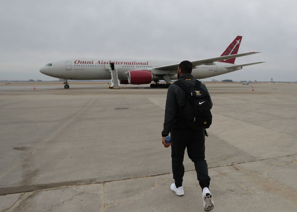 Iowa Hawkeyes running back Toren Young (28) boards the team plane Wednesday, December 26, 2018 as they travel to Tampa, Florida for the Outback Bowl. (Brian Ray/hawkeyesports.com)