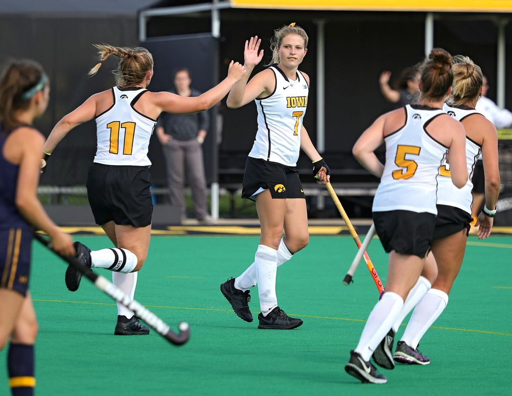 Iowa's Katie Birch (11) gets a high five from Ellie Holley (7) after scoring a goal during the fourth quarter of their game at Grant Field in Iowa City on Friday, Sep 13, 2019. (Stephen Mally/hawkeyesports.com)