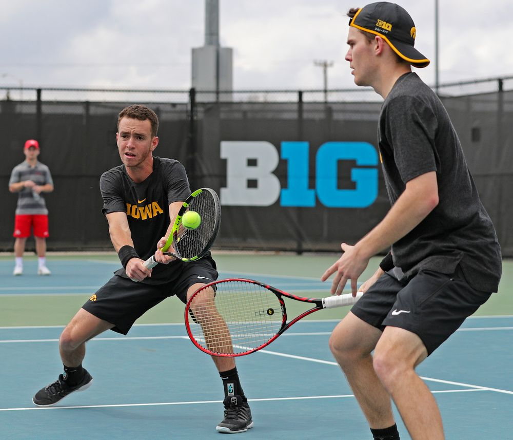 Iowa's Kareem Allaf (from left) returns a shot as Jonas Larsen looks on during a double match against Ohio State at the Hawkeye Tennis and Recreation Complex in Iowa City on Sunday, Apr. 7, 2019. (Stephen Mally/hawkeyesports.com)