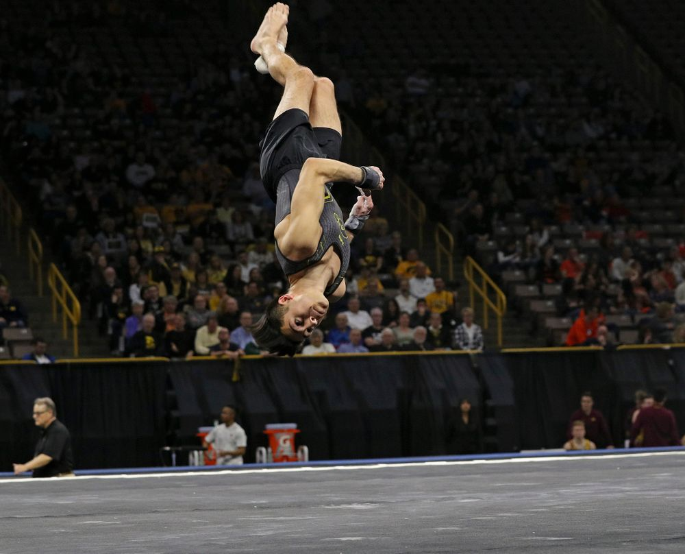 Iowa's Andrew Herrador competes in the floor during the first day of the Big Ten Men's Gymnastics Championships at Carver-Hawkeye Arena in Iowa City on Friday, Apr. 5, 2019. (Stephen Mally/hawkeyesports.com)