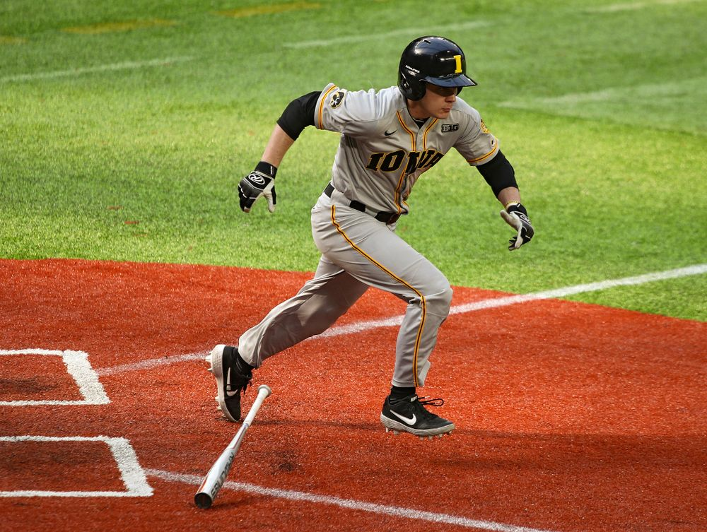 Iowa Hawkeyes utility player Sam Link (3) runs and reaches on an error during the third inning of their CambriaCollegeClassic game at U.S. Bank Stadium in Minneapolis, Minn. on Friday, February 28, 2020. (Stephen Mally/hawkeyesports.com)