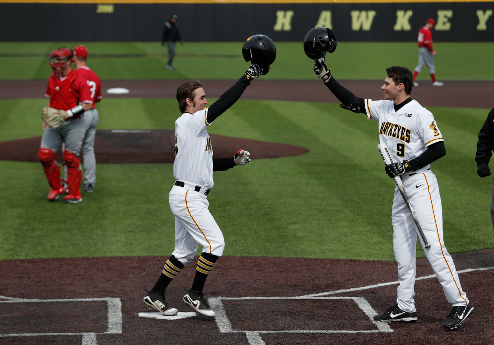 Iowa Hawkeyes outfielder Justin Jenkins (6) and outfielder Ben Norman (9) during a double header against the Indiana Hoosiers Friday, March 23, 2018 at Duane Banks Field. (Brian Ray/hawkeyesports.com)