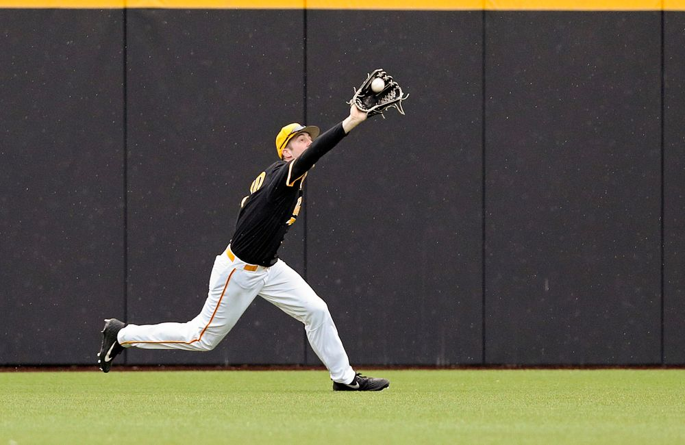 Iowa Hawkeyes right fielder Connor McCaffery (30) pulls in a fly ball for an out during the sixth inning of their game against Illinois State at Duane Banks Field in Iowa City on Wednesday, Apr. 3, 2019. (Stephen Mally/hawkeyesports.com)