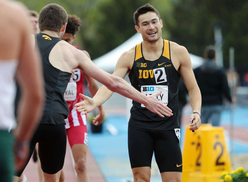Iowa's Nolan Teubel (from left) slaps hands with Carter Lilly after running the men's 800 meter event on the second day of the Big Ten Outdoor Track and Field Championships at Francis X. Cretzmeyer Track in Iowa City on Saturday, May. 11, 2019. (Stephen Mally/hawkeyesports.com)