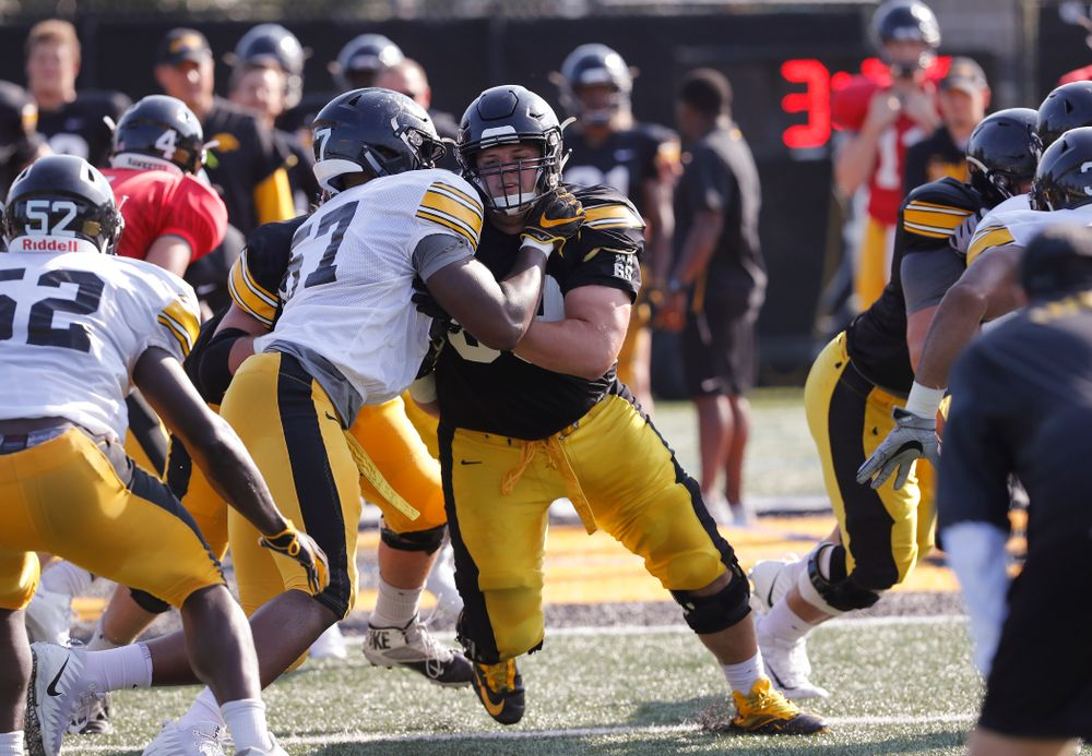 Iowa Hawkeyes offensive lineman Keegan Render (69) and defensive end Chauncey Golston (57) during camp practice No. 17 Wednesday, August 22, 2018 at the Kenyon Football Practice Facility. (Brian Ray/hawkeyesports.com)