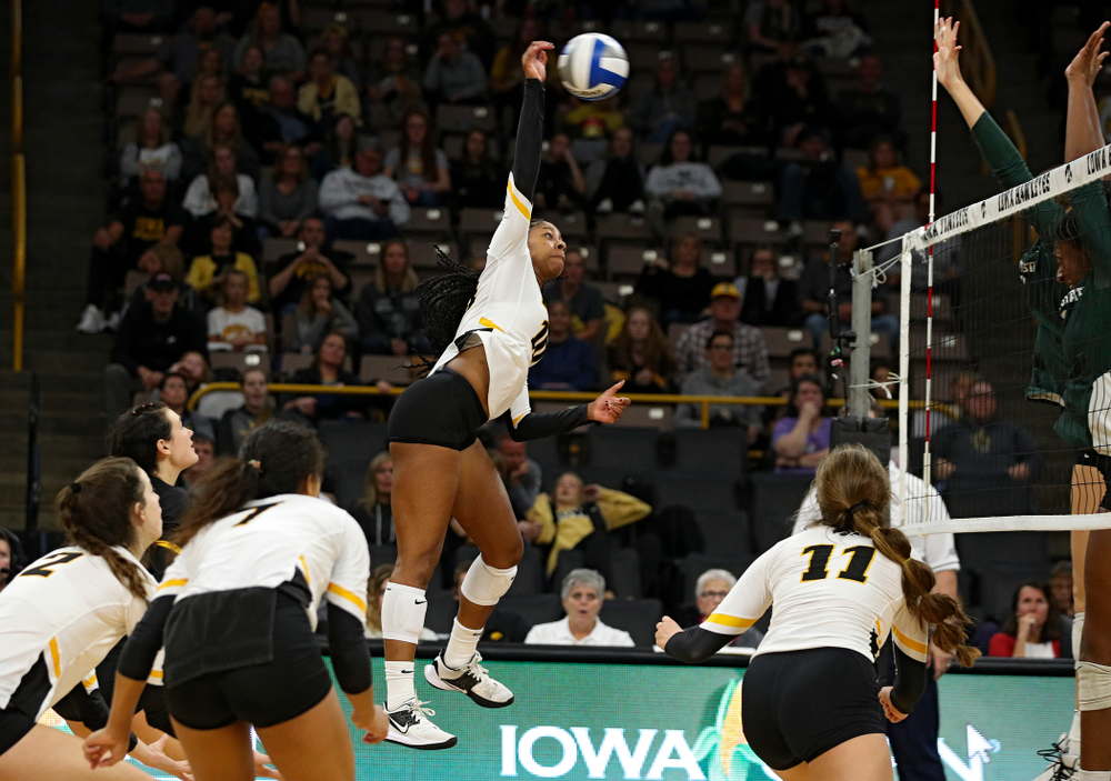 Iowa's Griere Hughes (10) lines up a shot during the fourth set of their volleyball match at Carver-Hawkeye Arena in Iowa City on Sunday, Oct 13, 2019. (Stephen Mally/hawkeyesports.com)