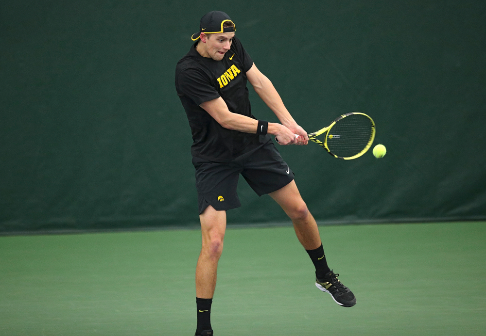Iowa's Joe Tyler returns a shot during his doubles match at the Hawkeye Tennis and Recreation Complex in Iowa City on Friday, March 6, 2020. (Stephen Mally/hawkeyesports.com)