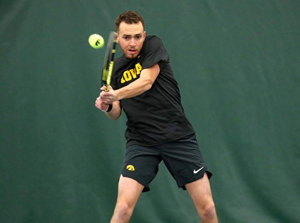 Iowa's Kareem Allaf returns a shot during his doubles match at the Hawkeye Tennis and Recreation Complex in Iowa City on Thursday, January 16, 2020. (Stephen Mally/hawkeyesports.com)