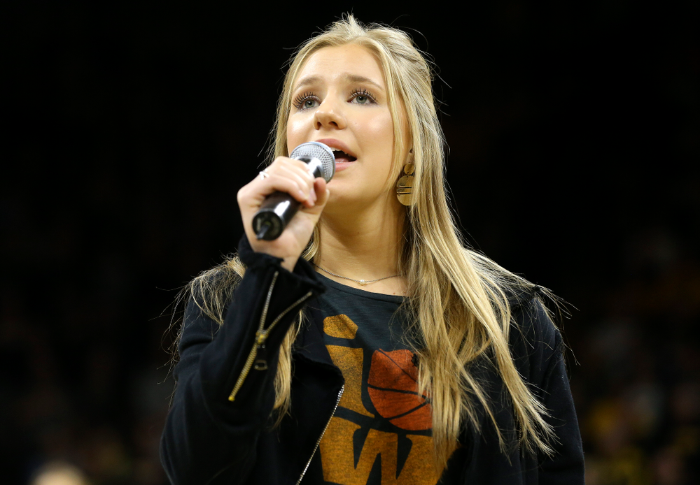 Emma Bluder sings the National Anthem before their second round game in the 2019 NCAA Women's Basketball Tournament at Carver Hawkeye Arena in Iowa City on Sunday, Mar. 24, 2019. (Stephen Mally for hawkeyesports.com)