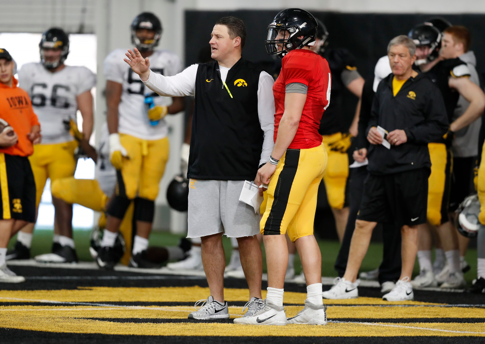 Iowa Hawkeyes offensive coordinator Brian Ferentz and quarterback Nathan Stanley (4) during spring practice Wednesday, March 28, 2018 at the Hansen Football Performance Center.  (Brian Ray/hawkeyesports.com)