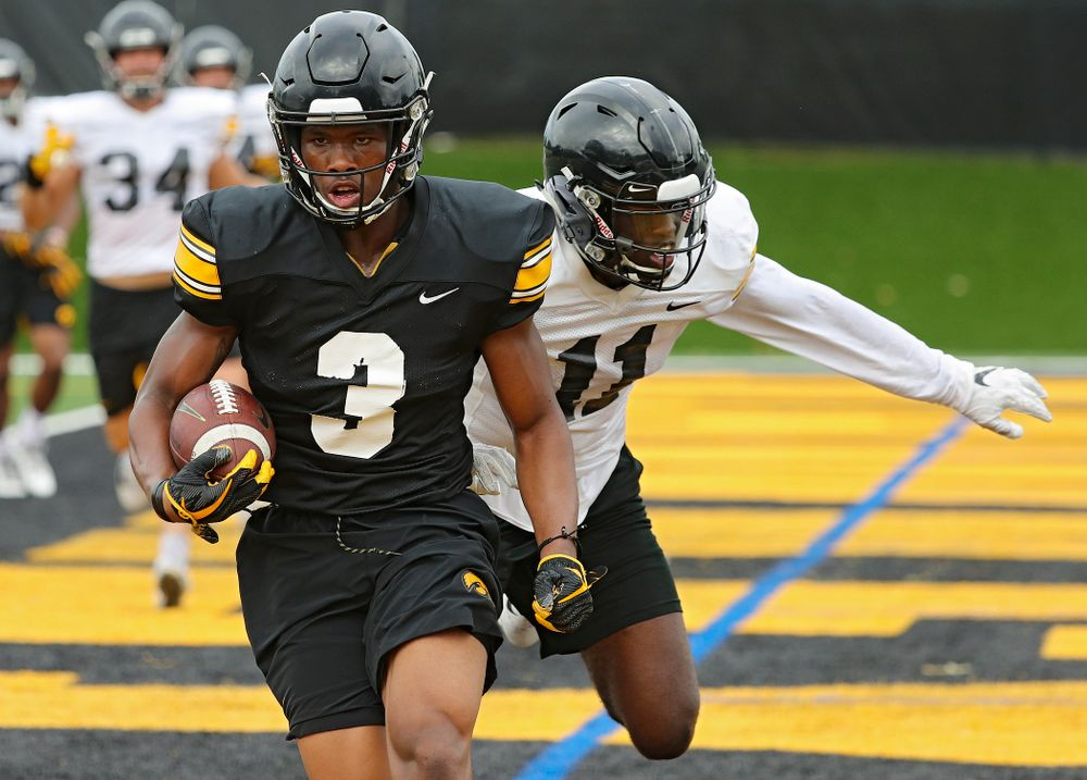 Iowa Hawkeyes wide receiver Tyrone Tracy Jr. (3) pulls in a pass in the end zone around defensive back Michael Ojemudia (11) during Fall Camp Practice No. 15 at the Hansen Football Performance Center in Iowa City on Monday, Aug 19, 2019. (Stephen Mally/hawkeyesports.com)