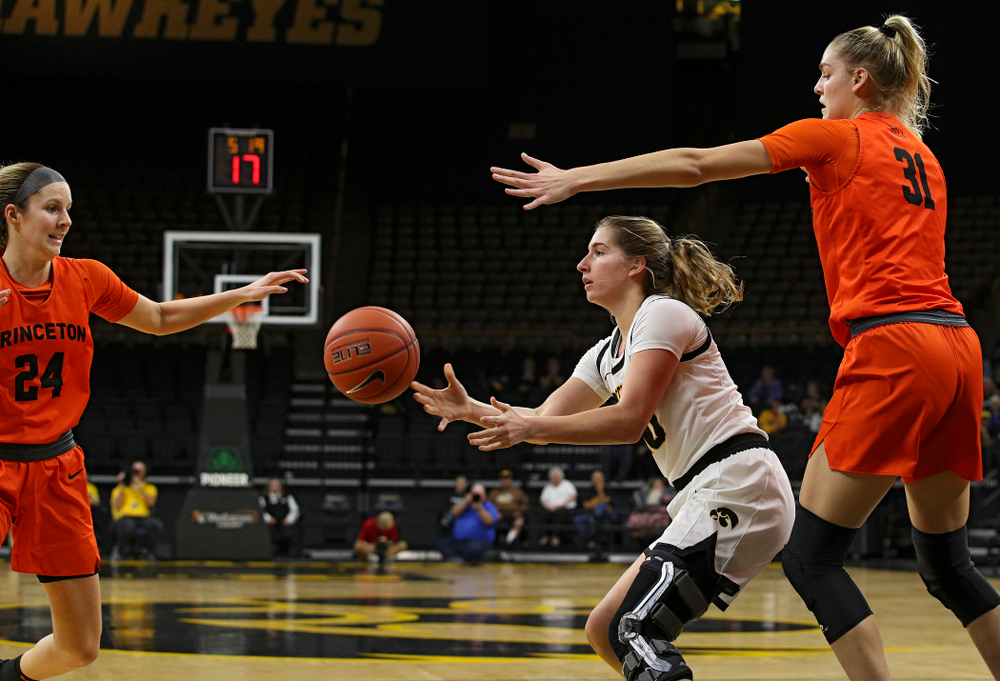 Iowa guard Kate Martin (20) passes the ball during the second quarter of their overtime win against Princeton at Carver-Hawkeye Arena in Iowa City on Wednesday, Nov 20, 2019. (Stephen Mally/hawkeyesports.com)