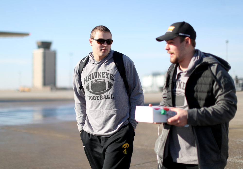 Iowa Hawkeyes quarterback Nate Stanley (4) boards the team plane at the Eastern Iowa Airport Saturday, December 21, 2019 on the way to San Diego, CA for the Holiday Bowl. (Brian Ray/hawkeyesports.com)