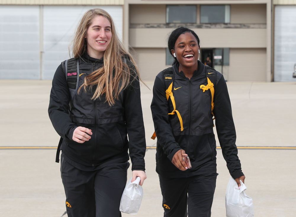 Iowa Hawkeyes guard Kate Martin (20) and guard Tomi Taiwo (1) board the team plane to Greensboro, NC for the Regionals of the 2019 NCAA Women's Basketball Championships Thursday, March 28, 2019 at the Eastern Iowa Airport. (Brian Ray/hawkeyesports.com)
