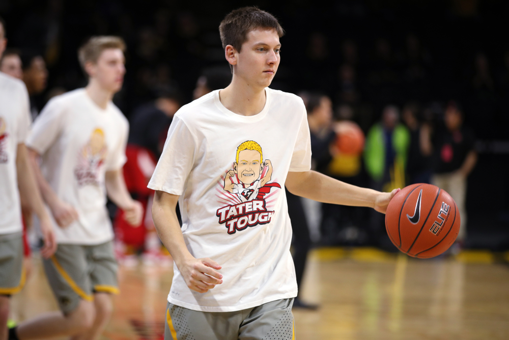 Iowa Hawkeyes guard Austin Ash (13) wears a Tater Tough t-shirt before their game against the Nebraska Cornhuskers Sunday, January 6, 2019 at Carver-Hawkeye Arena. (Brian Ray/hawkeyesports.com)