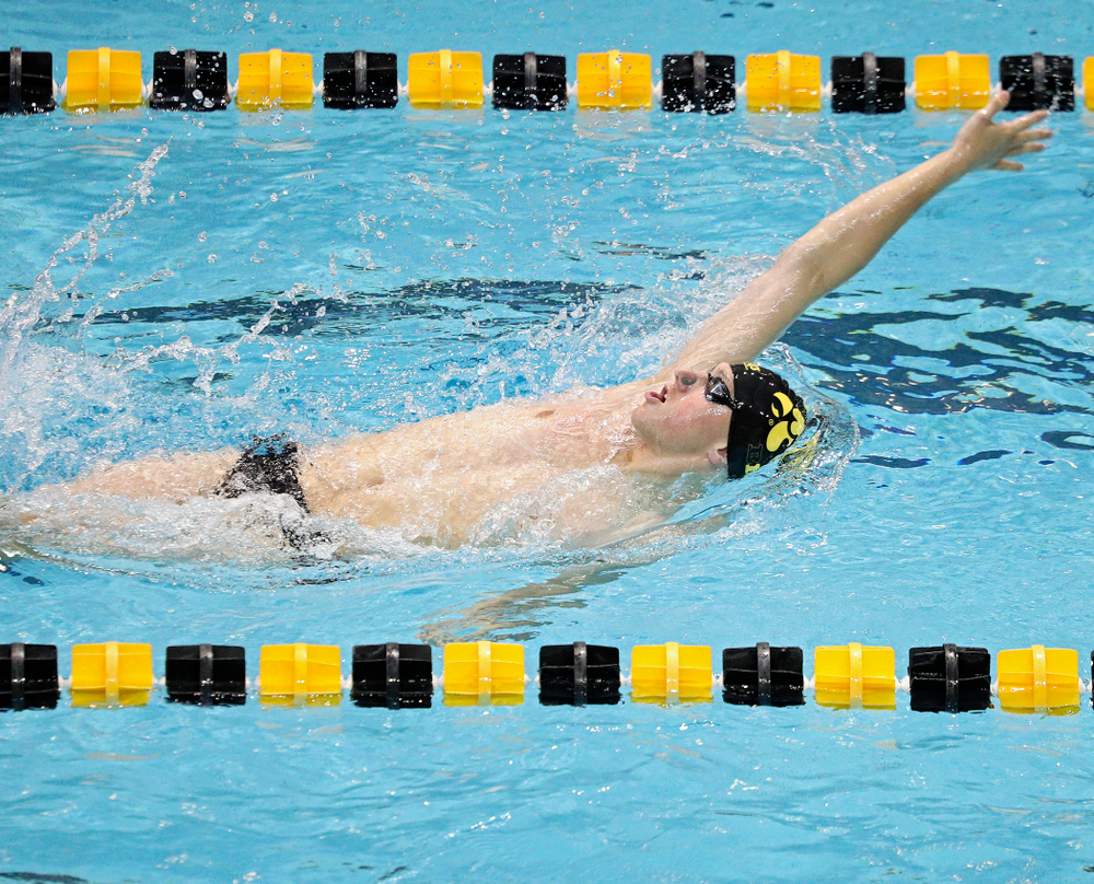 Iowa's John Colin swims the men's 200-yard backstroke event during their meet against Michigan State and Northern Iowa at the Campus Recreation and Wellness Center in Iowa City on Friday, Oct 4, 2019. (Stephen Mally/hawkeyesports.com)