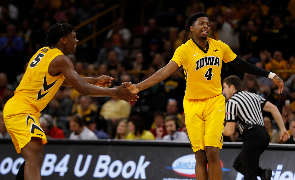 Iowa Hawkeyes forward Tyler Cook (5) and guard Isaiah Moss (4)