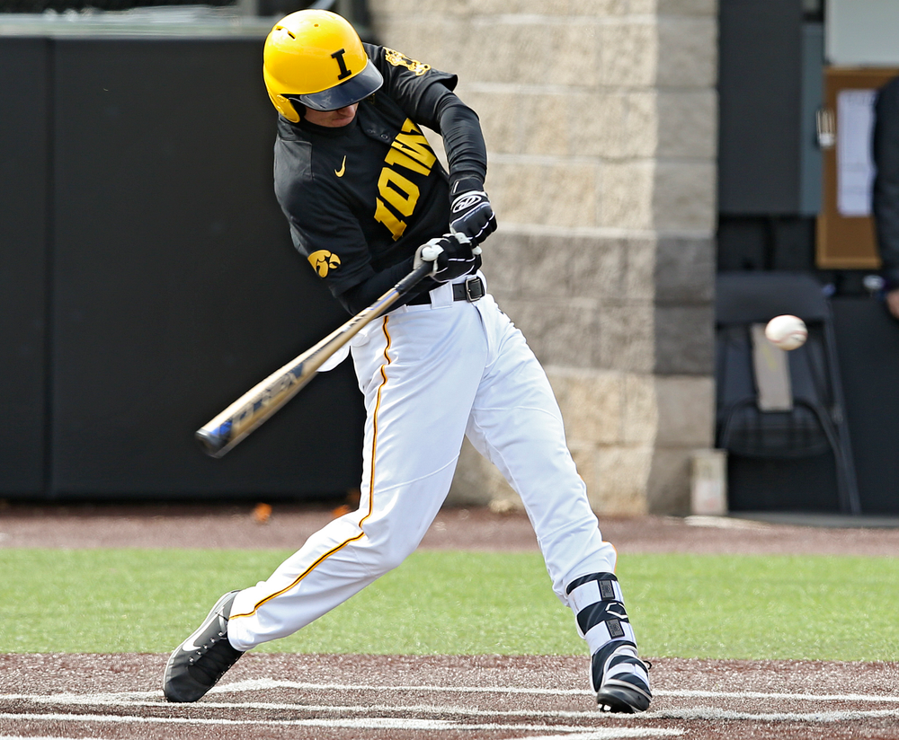 Iowa Hawkeyes shortstop Tanner Wetrich (16) with a 2-RBI single during the second inning of their game against Illinois at Duane Banks Field in Iowa City on Saturday, Mar. 30, 2019. (Stephen Mally/hawkeyesports.com)
