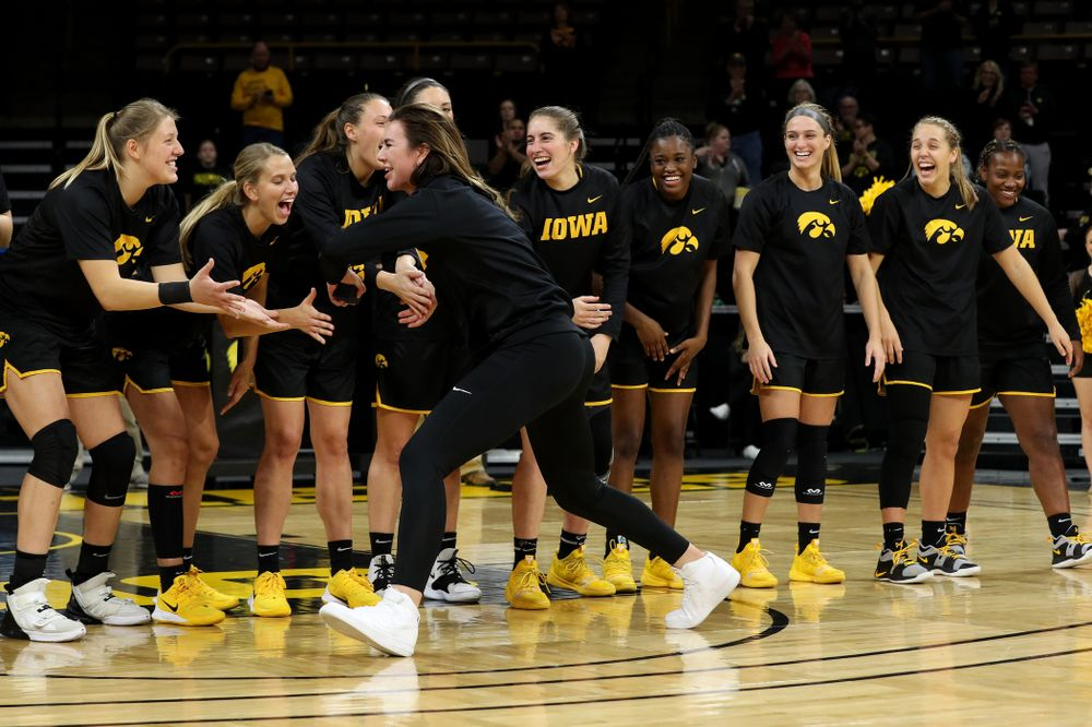 Former Hawkeye Hannah Stewart slaps hands with the Iowa Hawkeyes before their game against Clemson Wednesday, December 4, 2019 at Carver-Hawkeye Arena. (Brian Ray/hawkeyesports.com)
