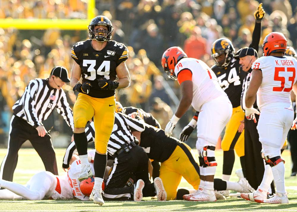 Iowa Hawkeyes linebacker Kristian Welch (34) celebrates after forcing a fumble during the fourth quarter of their game at Kinnick Stadium in Iowa City on Saturday, Nov 23, 2019. (Stephen Mally/hawkeyesports.com)