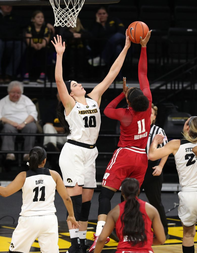 Iowa Hawkeyes forward Megan Gustafson (10) blocks a shot against the Wisconsin Badgers Monday, January 7, 2019 at Carver-Hawkeye Arena.  (Brian Ray/hawkeyesports.com)