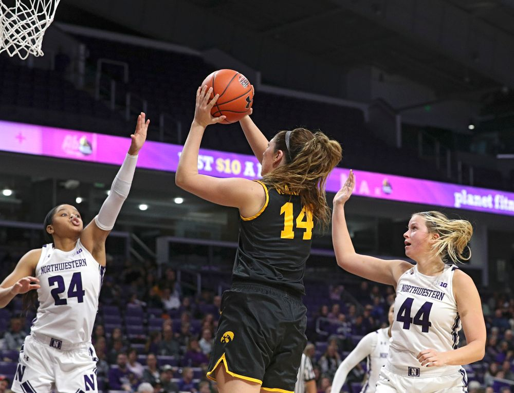 Iowa Hawkeyes guard Mckenna Warnock (14) makes a basket during the fourth quarter of their game at Welsh-Ryan Arena in Evanston, Ill. on Sunday, January 5, 2020. (Stephen Mally/hawkeyesports.com)