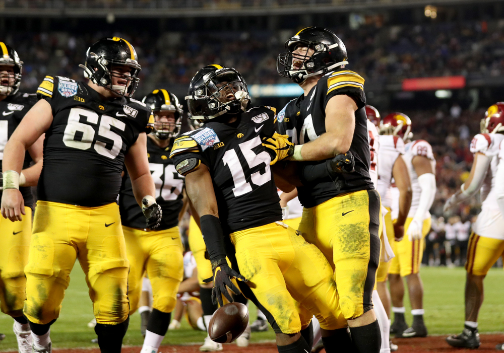 Iowa Hawkeyes running back Tyler Goodson (15) celebrates with tight end Sam LaPorta (84) after scoring against USC in the Holiday Bowl Friday, December 27, 2019 at San Diego Community Credit Union Stadium.  (Brian Ray/hawkeyesports.com)