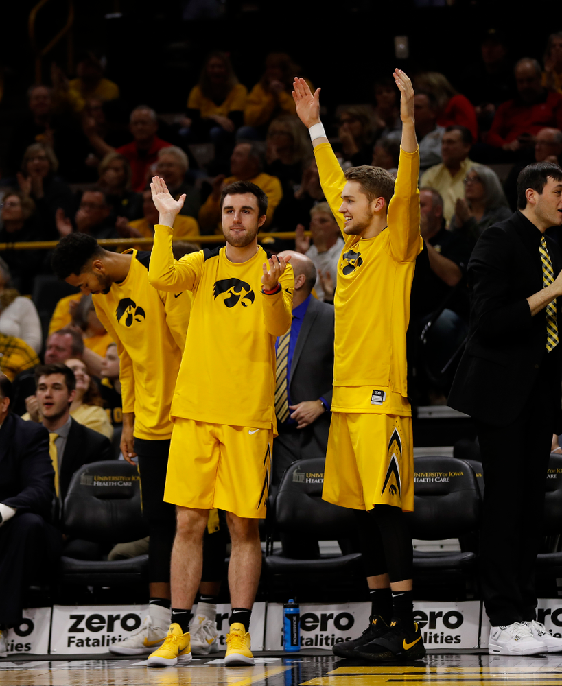 Iowa Hawkeyes forward Charlie Rose (11) and forward Riley Till (20)