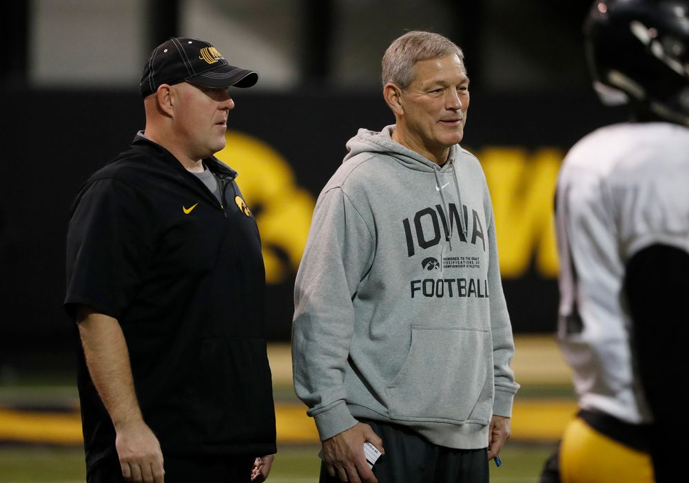 head coach Kirk Ferentz and strength and conditioning coach Chris Doyle