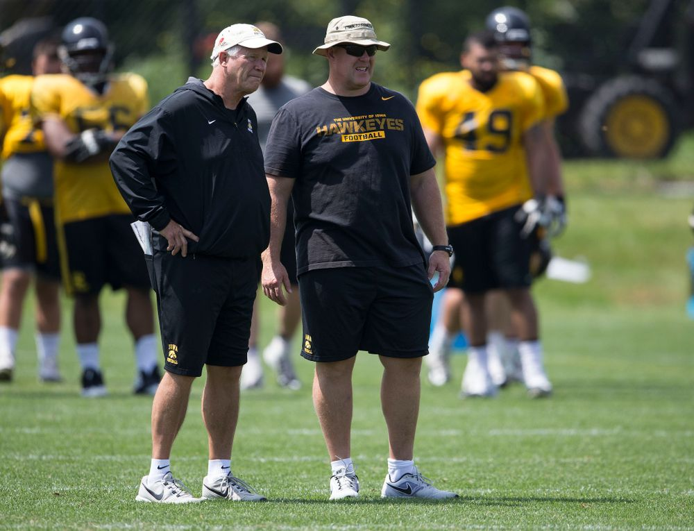 Iowa Hawkeyes Defensive Line coach Reese Morgan and Strength and Conditioning coach Chris Doyle talk during the team's sixth practice of camp Saturday, Aug. 9, 2014 at the Hayden Fry Football Complex in Iowa City.  (Brian Ray/hawkeyesports.com)