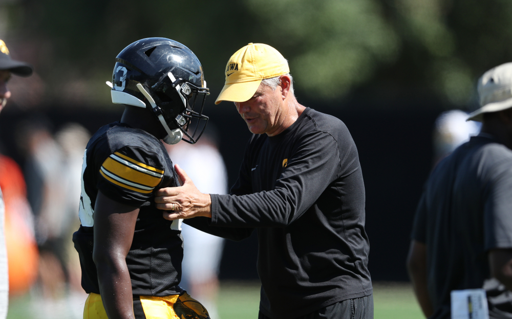 Iowa Hawkeyes head coach Kirk Ferentz and running back Shadrick Byrd (23) during Fall Camp Practice No. 5 Tuesday, August 6, 2019 at the Ronald D. and Margaret L. Kenyon Football Practice Facility. (Brian Ray/hawkeyesports.com)